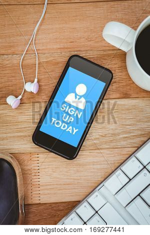 Sign up today against black smartphone with cup of coffee