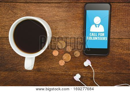 Call for volunteers against view of a black smartphone with a cup of coffee