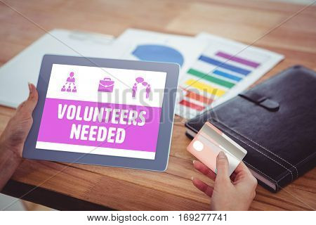 Yellow volunteers needed against over shoulder view of hipster woman using tablet