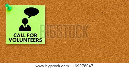 Call for volunteers against illustrative image of pushpin on green paper