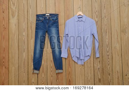 Set of Jeans- wooden background
