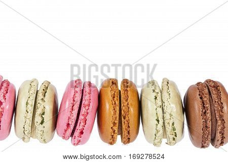 Colorful cookies of macaroon isolated on white background place for text