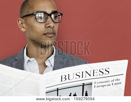 African Descent Business Man Newspaper Concept