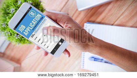 Job application on smartphone against overhead of feminine hand using smartphone