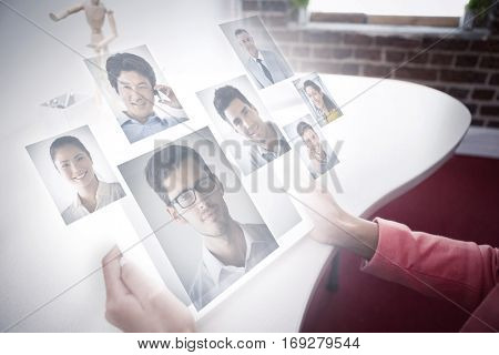 Portrait of business people against casual businesswoman using tablet pc