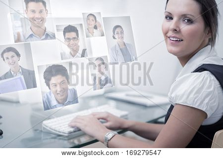 Portrait of business people against confident female executive using computer at office