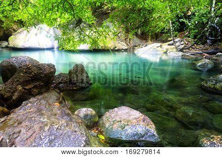 Erawan Waterfall with stone and green forest in Kanchanaburi Thailand