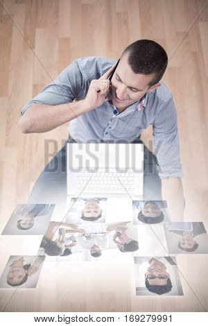 Business people having a meeting against businessman talking on mobile phone