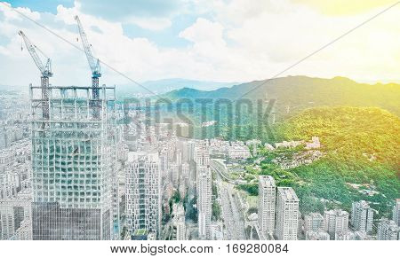 Asia Business concept for real estate - panoramic modern cityscape building bird eye aerial view under sunrise and morning blue bright sky in Taipei Taiwan. Mix hand drawn sketch illustration
