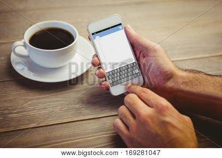 Smartphone text messaging against person holding smartphone