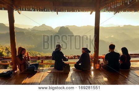 November26 2016 - Mae Hong Son THAILAND : People relaxing and enjoying sunrise at view point in the noodle shop at ban ja bo Mae Hong Son Thailand