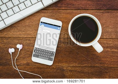 Smartphone texting apps against view of a mug of coffee and a smartphone