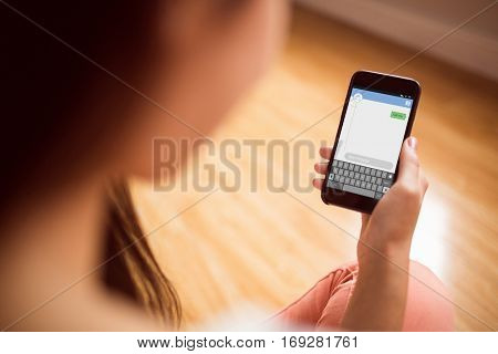 Smartphone text messaging against asian woman using phone with copy space