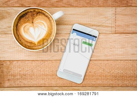 Smartphone text messaging against view of a heart composed of coffee
