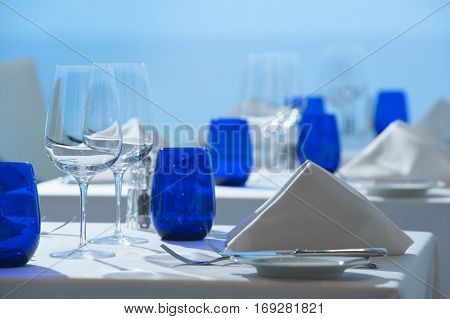 Simple clean white linen elegant table top at fine restaurant dining experience