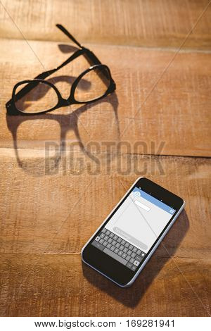 Smartphone texting apps against close up view of smartphone and glasses