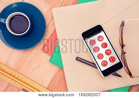 Telephone apps icons against smartphone and eye glasses on paper by coffee cup at table