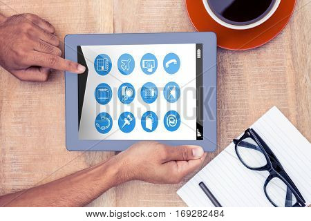 Telephone apps icons against cropped image of person using on digital tablet
