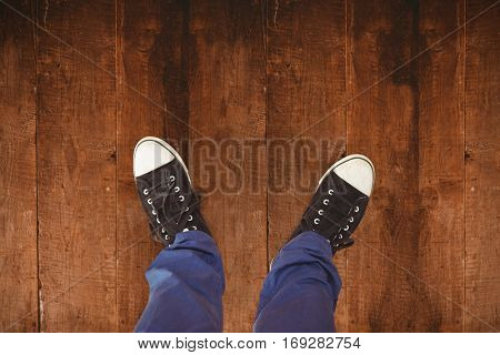 Man standing on hardwood floor against weathered oak floor boards background