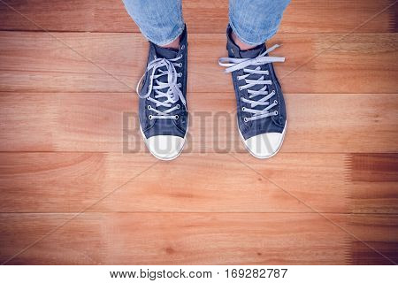 Casual shoes against wooden flooring