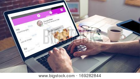 Smartphone chat against cropped hand of graphic designer using laptop