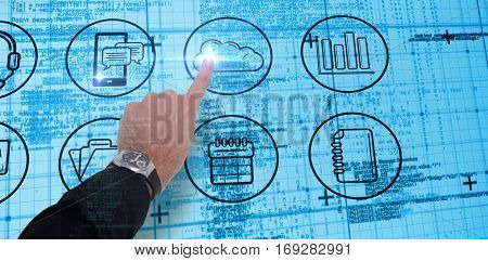 Businessman hand with watch pointing something against blue matrix and codes