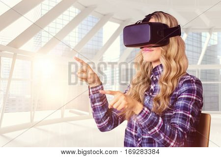 Pretty casual worker using oculus rift against modern room overlooking city