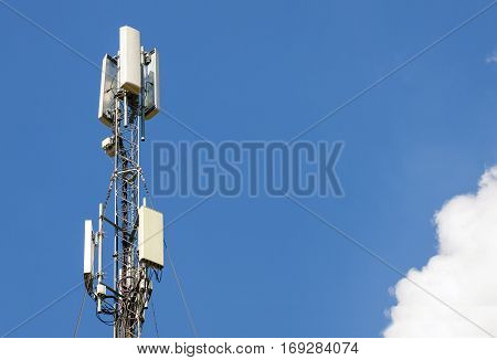 Communication antenna tower with blue skyTelecoms technology. Mobile phone base station