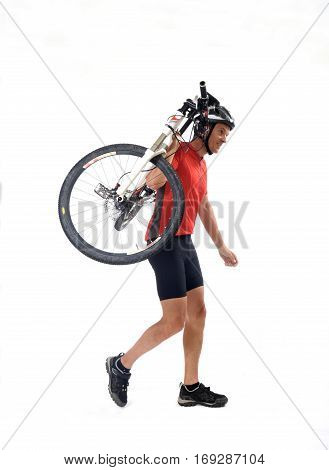 A cycler carrying a Mountain bike on white background