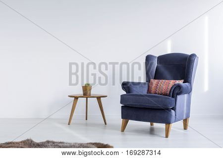 White Room With Blue Armchair