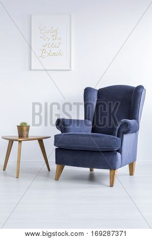 Blue Armchair And Side Table