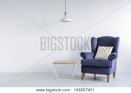 Ascetic Room With Blue Armchair