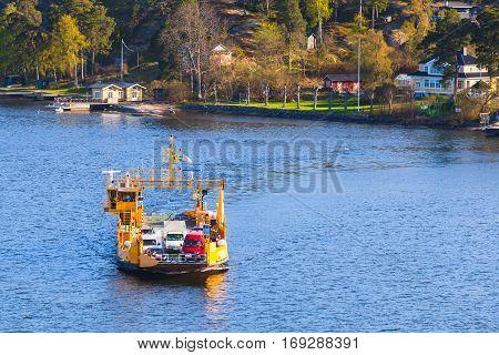 Yellow Ro-ro Cargo Ship Crossing River