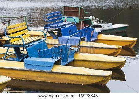 Old Yellow Blue Promenade Catamarans