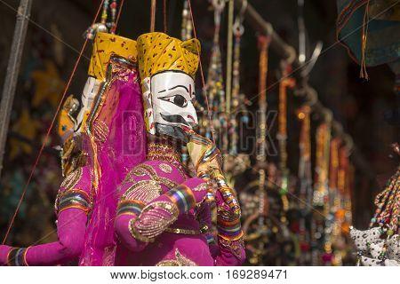 India art style pupet hanging display in shopfront in Pushkar rajasthan India