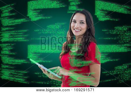 Happy woman using tablet against green background with vignette