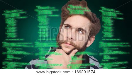 Close-up of thoughtful hipster with hand on chin against green background with vignette