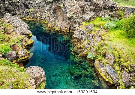 Cliffs And Deep Fissure In Thingvellir National Park, Iceland