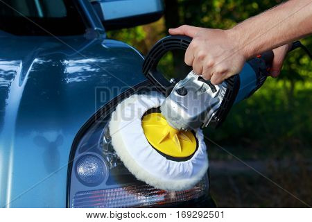blue car is polishing on open air