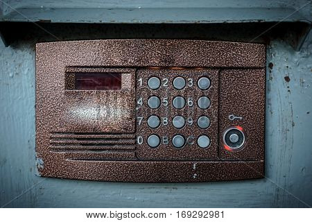 Old vintage intercom on apartment building doors