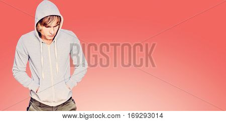 Man in hood jacket thinking against orange Man in hood jacket thinking with black background