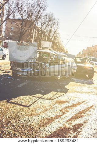 Car crash accident on street of Voronezh, damaged automobiles after collision in city. Image with copy space