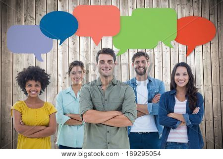 Group portrait of happy young colleagues against wooden planks background