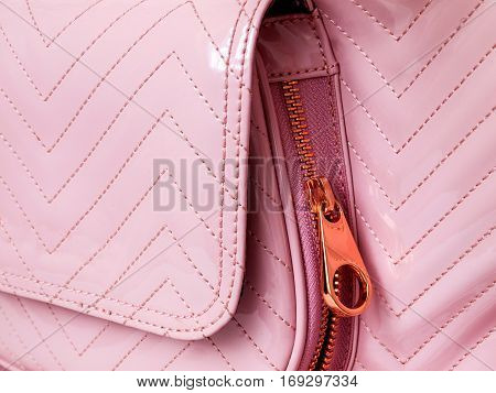 Luxury pink leather detail handbag with metal lock zipper closeup