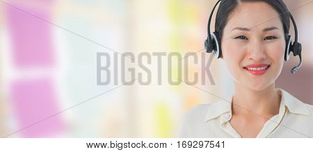 Beautiful smiling female executive with headset against colorful adhesive notes