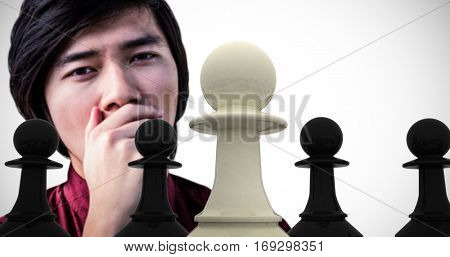 Hipster yawning with his hand over his mouth against white pawn standing with black pawns