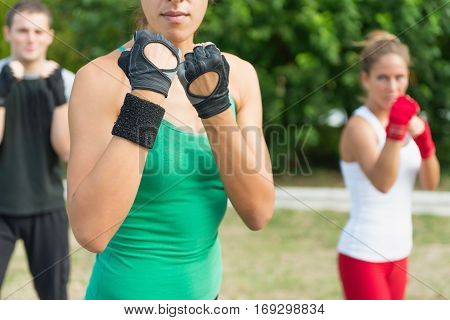 Tae Bo team in guard positions, toned image