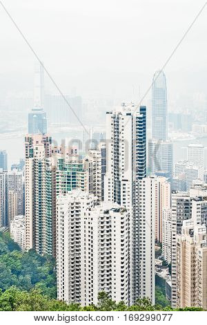 Business concept for real estate and corporate construction - panoramic modern city skyline bird eye aerial view with morning grey sky in Hong Kong (HK) China