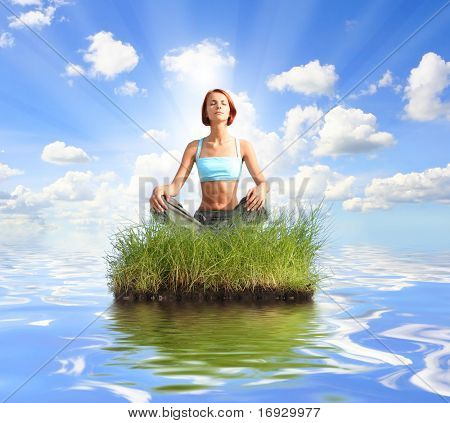 joung girl meditating on island