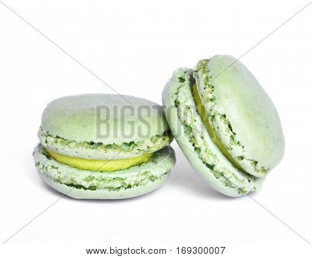 Delicious multicolored macaroons, isolated on white background. Studio isolated pistachio macaroon candy.